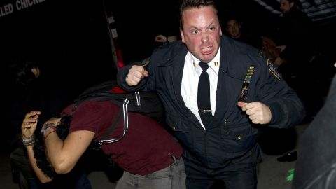 A New York City police officer scuffles with Occupy Wall Street protesters after they were evicted from lower Manhattan's Zuccotti Park on November 15, 2011 in New York. (DON EMMERT/AFP/Getty Images)