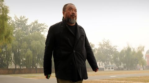 Chinese artist Ai Weiwei exercises in a car park in Beijing on November 16, 2011.