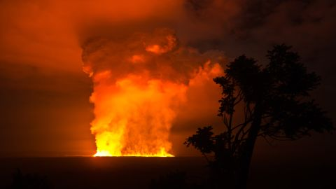 A skyline photograph taken from a high vantage point shows the immense power of the Nyamulagira volcano.