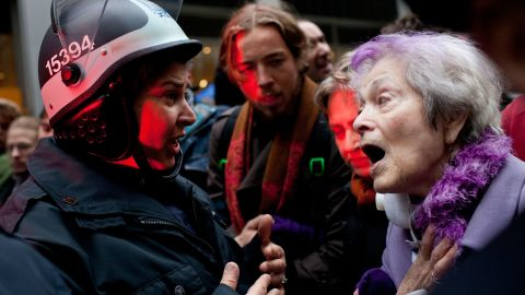 A woman talks with police as demonstrators block roads and tie up traffic in Lower Manhattan.