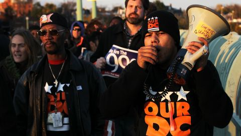 """Members of Our DC and Occupy DC take part in the nationwide """"day of action."""""""