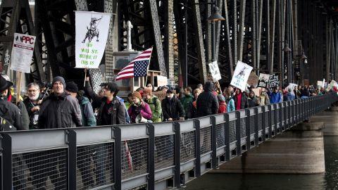 Demonstrators march across the Steel Bridge in Portland on Thursday.