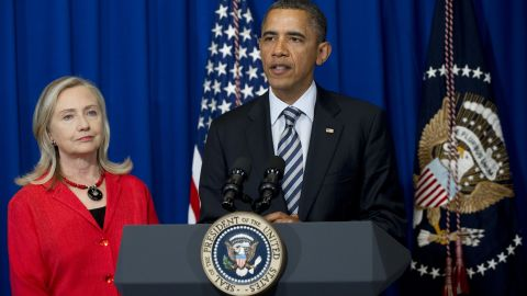 US President Barack Obama speaks alongside US Secretary of State Hillary Clinton while announcing that Clinton will travel next month to Myanmar to discuss renewing US dialogue with the country.