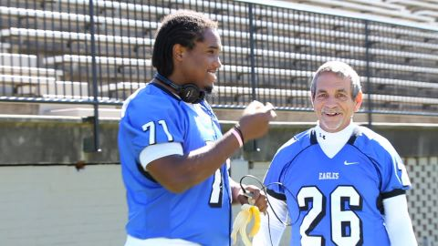 Moore cuts up with offensive lineman David Clemons prior to the Campbellsville game.