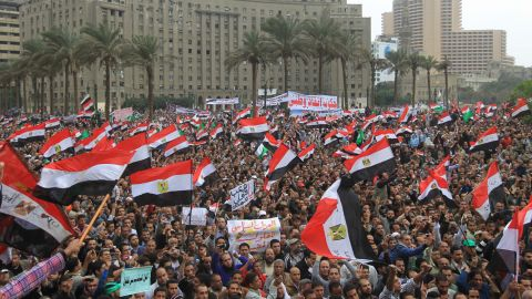 Tens of thousands of Egyptian protesters wave national flags during a rally in Cairo's Tahrir Square on November 18, 2011.