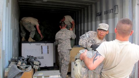 Troops in Kuwait load gear at Camp Virginia, which is located a short distance from the border crossing used in the 2003 invasion that toppled Saddam Hussein.