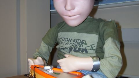 Also being used to help autistic children, KASPAR was created at the UK's University of Hertfordshire. Its face is a silicon-rubber mask and its eyes are fitted with video cameras. Its mouth can open and smile.