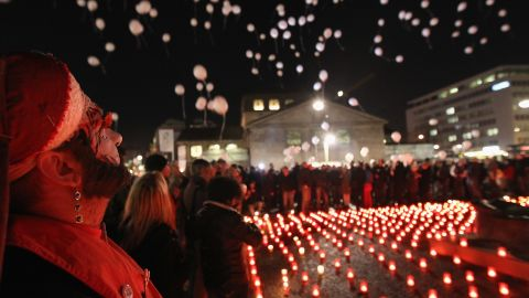 Balloons are released next to a sea of candles at the World Aids Day memorial in Berlin on November 30, 2011.