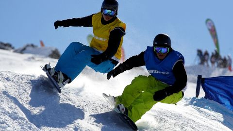 Release a few endorphins, improve your flexibility and work on major muscle groups in your legs -- such as hamstrings, calves and quads -- as you burn at least 450 calories an hour snowboarding or skiing.  Studies show that outdoor exercise can also improve moods and reduce levels of anxiety.