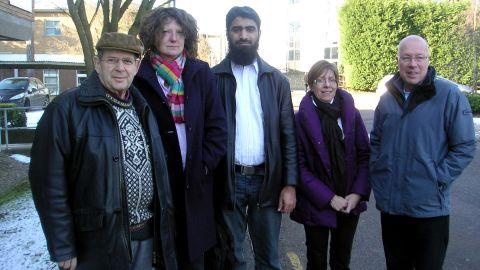 Warren Weinstein is at left with Ali Amjad (center), Mark Wilkinson and Waste Management staff members.