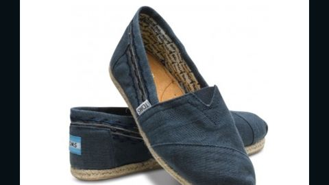 """If you want to give the gift of shoes this holiday season, <a href=""""http://www.toms.com/our-movement/movement-one-for-one"""" target=""""_blank"""" target=""""_blank"""">TOMS One for One program</a> donates one pair of shoes to a child in need for each for each pair of Toms that's purchased. The campaign also applies to <a href=""""http://www.toms.com/eyewear/our-movement/"""" target=""""_blank"""" target=""""_blank"""">TOMS Eyewear.</a> Each pair of glasses purchased will help restore sight to people in need by providing medical treatment, prescription glasses or sight-saving surgery."""