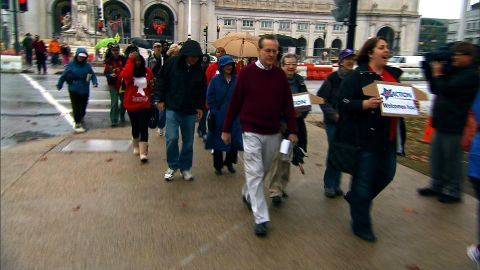 Protesters march the DC streets to the door of Rep. Chris Van Hollen.