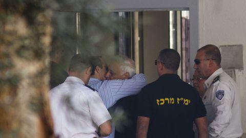 Former Israeli President Moshe Katsav hugs his son before starting a 7 year prison sentence for rape and sexual offenses.