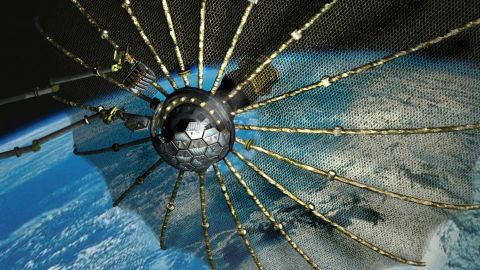"""The Phoenix program aims to find a way to remove and re-use valuable components from broken or """"retired"""" satellites (artist's impression)."""