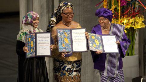 The 2011 Nobel Peace Prize laureates, Liberian President Ellen Johnson Sirleaf (R), Liberian peace activist Leymah Gbowee (C) and Yemeni activist Tawakkol Karman (L) pose on December 10, 2011