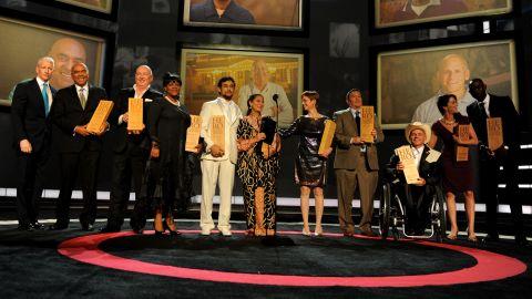 CNN's Anderson Cooper joins honorees Patrice Millet, Bruno Serato, Diane Latiker, Sal Dimiceli, 2011 CNN Hero of the Year Robin Lim, Amy Stokes, Eddie Canales, Richard St. Denis, Taryn Davis and Derreck Kayongo.