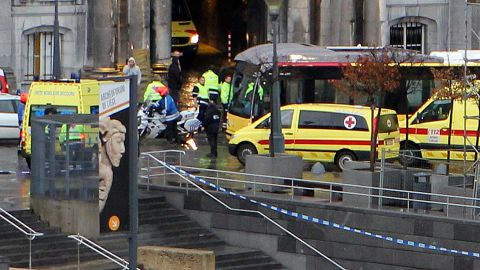 Ambulances and police are parked on the Place Saint-Lambert in Liege as a medical team arrives in the area after a gunman attack on December 13, 2011. A lone gunman was behind today deadly attack on a city square crowded with children and Christmas shoppers in the Belgian town of Liege, the public prosecutor said.