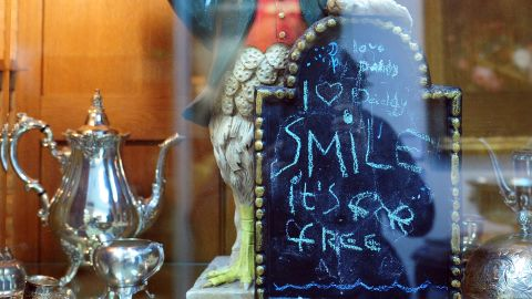"""A chalkboard left behind in Jackson's kitchen retains notes written by the singer's children. The note, attached to a 26-inch-tall ceramic rooster, reads """"love Daddy/ I (heart) Daddy/ Smile it's for free."""""""