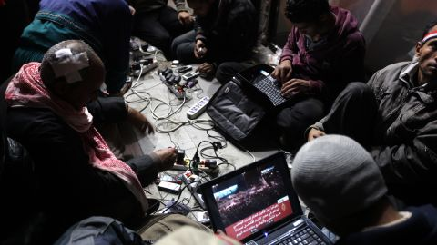 Egyptian anti-government bloggers work on their laptops from Tahrir Square during last year's uprising to oust Hosni Mubarak