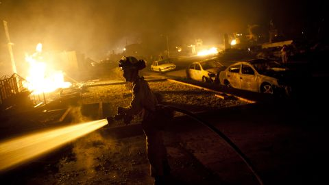 A firefighter works on a gas pipeline blaze September 9, 2010, in San Bruno, California.
