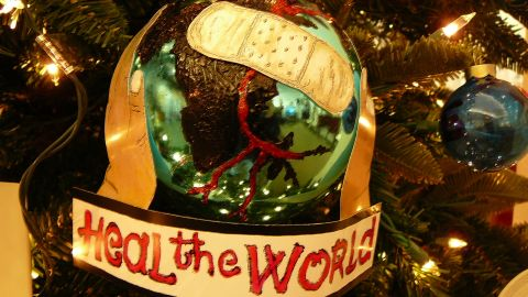 """This Christmas tree ornament, with a reference to Jackson's 1991 song """"Heal the World"""", was on display at the Beverly Hills auction."""
