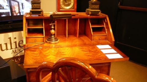 Another featured item was this federal style secretary desk with highly figured polished wood. It was expected to bring in between $800 - $1,200.