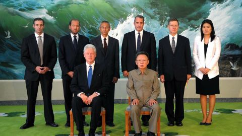This photo taken on August 4, 2009 and released by North Korea's official Korean Central News Agency shows North Korean leader Kim Jong Il (Front R) posing with former US President Bill Clinton (Front L) and his delegation members in Pyongyang