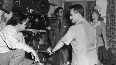 """Cinematographer Gregg Toland, left, William Wyler, Dana Andrews and Virginia Mayo on """"The Best Years of Our Lives"""" set."""