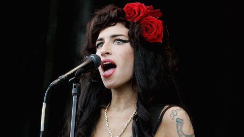 """Singer Amy Winehouse was found dead July 23 in her London apartment. The 27-year-old performer infamous for her arrests and substance abuse problems died of alcohol poisoning. <a href=""""http://articles.cnn.com/2011-07-23/entertainment/amy.winehouse.dies_1_drug-overdoses-winehouse-spokesman-chris-goodman-singer-amy-winehouse?_s=PM:SHOWBIZ"""">Full story</a>"""