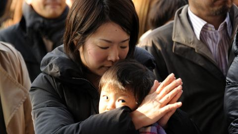 A businesswoman prays for a good business year as worshippers gather at the Kanda shrine in Tokyo on January 4, 2012.