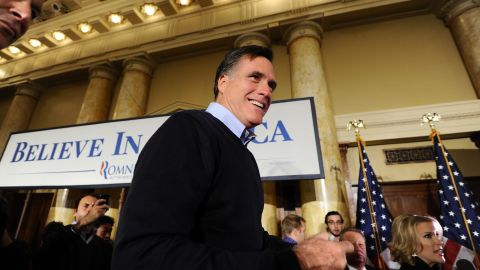 Republican presidential hopeful Mitt Romney greets supporters during a campaign rally Tuesday in Des Moines, Iowa.