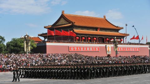 Chinese People's Liberation Army (PLA) soldiers march past Tiananmen Square during the National Day parade in Beijing on October 1, 2009.