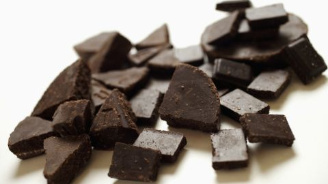 """While researchers aren't positive that <a href=""""http://thechart.blogs.cnn.com/2012/03/26/could-eating-chocolate-make-you-thinner/"""">eating chocolate will make you thinner</a>, the heart benefits of dark chocolate have long been recognized. Antioxidants and anti-inflammatory properties may help offset the calories. And some scientists believe chocolate's caffeine could increase your metabolic rate. Still, stick to small pieces that will curb cravings without overloading your body with sugar."""