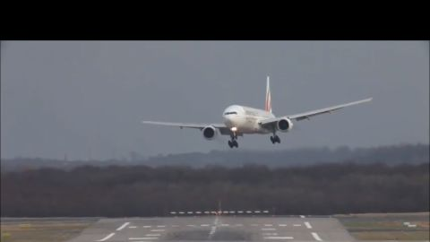 Planes landing at Düsseldorf International Airport cope with crosswinds during a storm.