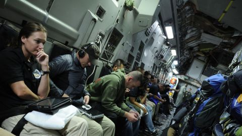 JPAC team members on a U.S. Air Force C-17 aircraft enroute to a recovery operation in Vietnam. They travel the world looking for the remains of service personnel killed in U.S. military action.