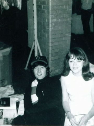 """iReporter Lynn Kordus said her most memorable """"Kodak moment"""" was with the Beatles in 1965. Here she poses with John Lennon while he thumbs through a magazine. <a href=""""http://ireport.cnn.com/topics/726798"""">See more Kodak moments on CNN iReport.</a>"""
