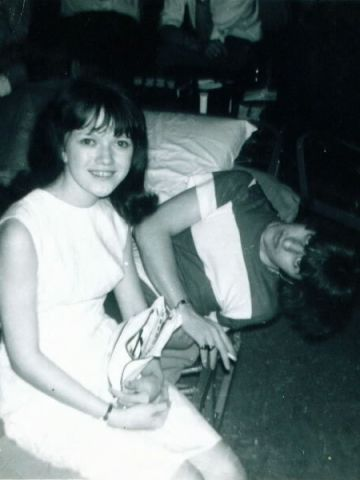 Kordus sits with Beatles drummer Ringo Starr, who was watching TV before the band performed in Bloomington, Minnesota.