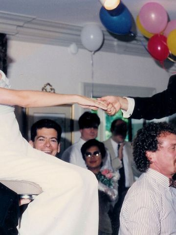 """""""Kodak captured the joy of my daughter's traditional Jewish wedding (in 1994) when she and her new husband were carried aloft by guests,"""" Linda Woodward said. <a href=""""http://ireport.cnn.com/topics/726798"""">See more Kodak moments on CNN iReport.</a>"""