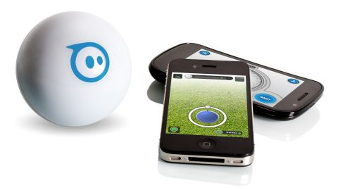 """This <a href=""""http://www.gosphero.com/"""" target=""""_blank"""" target=""""_blank"""">rechargeable robotic toy</a>, about the size of a softball, acts as if it has a mind of its own. But really it's controlled via Bluetooth by your Apple or Android device. You can make the ball roll around the house, change colors, play games and spook the family pet. Available: this month. Price: $129."""