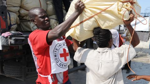 A Red Cross worker helps distribute supplies in Port-au-Prince, Haiti, in 2010.