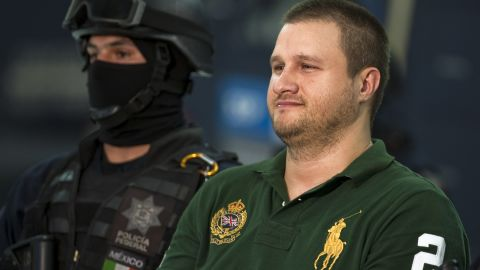 A heavily guarded Edgar Valdez Villareal smiled as he stood in front of reporters after his 2010 arrest in Mexico.