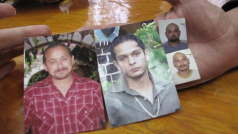 """Maria Herrera Magdalena holds photos of her four missing children: Salvador, Raul, Gustavo and Luis Armando. """"When I start to talk about my sons, I can't stop crying,"""" she says."""