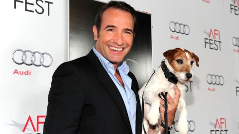 Actor Jean Dujardin was accompanied by his on-screen pet at the Golden Globes.