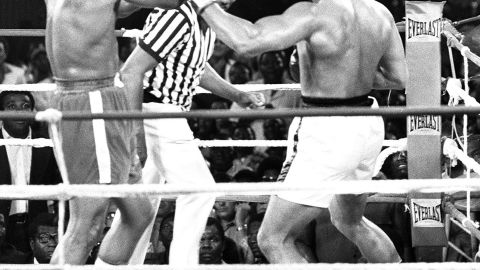 """In 1974, Ali took part in one of the most famous world championship fights in the history of boxing. He took on reigning champion George Foreman in Zaire, in a fight which was dubbed the """"Rumble in the Jungle."""" Ali emerged victorious after flooring Foreman in the eighth round."""