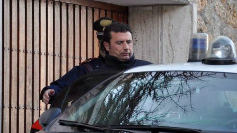 Italian police escort the captain of the Costa Concordia cruise liner, Francesco Schettino, on January 14. Prosecutors accused the captain of piloting the ship too fast to allow him to react to dangers, causing the shipwreck, according to legal papers.