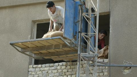 Iraqis work on a construction project in Baghdad in October 2003.