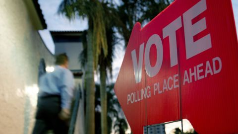 A Republican primary voter heads to the polls early at polling precinct No. 133 at the Coliseum in St. Petersburg, Florida. Polling booths opened in Florida on January 31, the largest state so far in the Republican White House race, with Mitt Romney holding a solid lead over Newt Gingrich in the latest polls.     AFP PHOTO / PAUL J. RICHARDS (Photo credit should read PAUL J. RICHARDS/AFP/Getty Images)