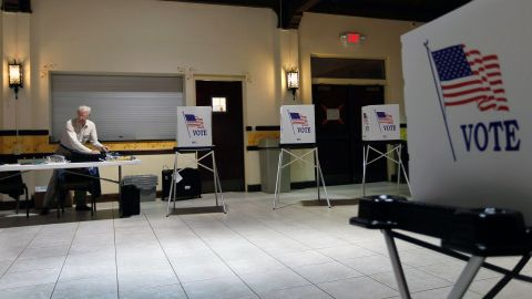 TAMPA, FL - JANUARY 31:   Ray Roy sets up a polling station as they prepare for voters on primary day on January 31, 2012 in Tampa, Florida. Republican voters head to the polls as their party continues the process of deciding who will be their general election candidate against President Barack Obama.  (Photo by Joe Raedle/Getty Images)