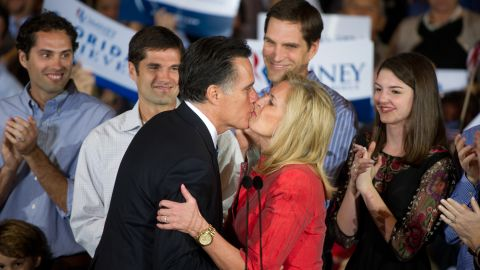 Florida Republican primary winner Mitt Romney and his wife Ann kiss after Romney won the Florida Republican primary at election night headquarters inside the Tampa Convention Center January 31, 2012, in Tampa, Florida. AFP Photo/Paul J. Richards (Photo credit should read PAUL J. RICHARDS/AFP/Getty Images)