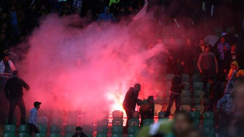 Flares are thrown in the stadium during clashes that erupted after a football match between Egypt's Al-Ahly and Al-Masry teams in Port Said.